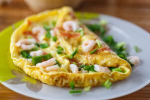 Omelett mit Tomaten und Krabben